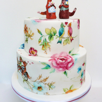 A Quirky Wedding Cake For A Lovely Couple They Made The Toppers Themselves And The Cake Included Paintings Of Birds With Hats And Bicycling... A quirky wedding cake for a lovely couple. They made the toppers themselves and the cake included paintings of birds with hats and...
