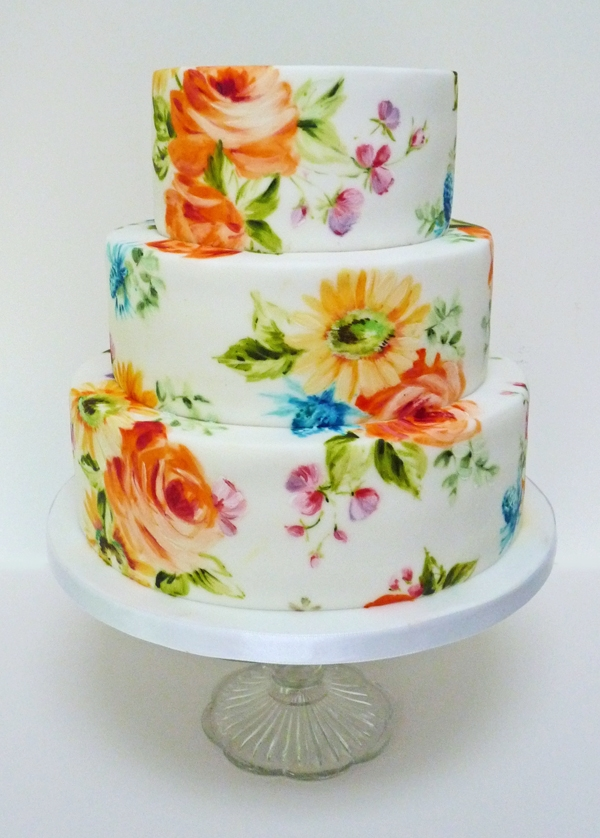 Bright Wedding Cake This is a painted cake using the lowers for the wedding, They were nice and bright with orange roses, yellow gerberas and pink and purple...
