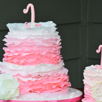 Pink Ombre Ruffle Cake a pretty vintage ombre ruffled two tiered cake and smash cake for a beautiful 1 year old!! Flavors included.. 1st Tier: alternating layers...