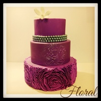 Wedding Cakes Purple 3 tier ruffled rosette and embossed peony wedding cake