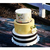 Vintage Stripes Top tier is wafer wrapped middle tier gold luster dry brushing and the bottom modeling chocolate stripes accented with an edible rose made...