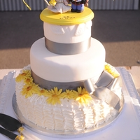 A Lady, Her Sunflowers, And Her Marine Most important wedding cake I've done ....my daughter's! :-) Bottom tier ruffled SMBC topped with fondant sunflowers, mid tier...