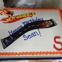 "Hot Wheels Birthday Cake Sheet cake with BC, fondant Hot Wheels and age on fondant, Wilton Sugar Sheets! ""road"". Little boy's favorite colors are..."