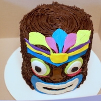 Luau Party Cake 4 6 inch layers stacked with chocolate frosting, MM fondant accents.