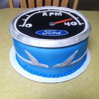 Ford Falcon Cake A friend is nearing 40..Tachometer cake with falcons on the side. Color of his 1965 restored Falcon :)