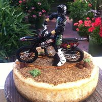 Grooms Dirtbike Cheesecake My good friend wanted a cheesecake for his grooms cake :) he's an avid dirtbike rider. My son lent me the dirtbike for the cake with...