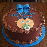 Baby Shower Cake Dark chocolate cake, Rich's Chocolate buttercream filling with ganache. Fondant Baby face, gumpaste bow. For my new nephew Tyler :)