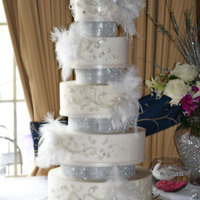 Diamonds And Feathers And Cake....oh My 5 tier Swiss Meringue Buttercream wedding cake with fondant detail.