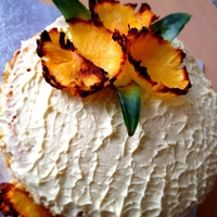 Fresh Pineapple Gateau a three layered juicy gateau with luscious whipped cream and decorated with slices of roasted pineapple and the sides were slapped with...