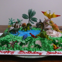 Dinosaur King Cobra Birthday Cakewhite Cake 9 X 13 And The Hills Are Made Of Devils Food Cake Butter Cream Icing Grass Done With Tip 233 Dinosaur King Cobra Birthday Cake.White cake 9 x 13 and the hills are made of Devils Food Cake. Butter cream icing. Grass done with tip 233...