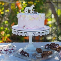 Pink And Flowers Cake With Unicorn. This is the cake all set up with a porcelain unicorn, bunny and cute little mouse.