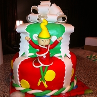 Elf Cake A lot of my cake ideas come from the internet. Im very new at this, Im not that creative yet. The only problem with this cake is the legs...