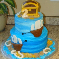 Pirate Themed 2Nd Birthday Cake Two tier chocolate cake frosted in vanilla BC with fondant decorations. The treasure chest is also cake, covered in fondant.
