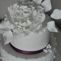 Large White Feature Rose This is a wedding cake that I have made with a handmade sugar rose on the top