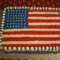 Flag Cake Cake I made for my husband's work office. 4 layer vanilla buttermilk cake with raspberry, cream cheese, and blueberry fillings....