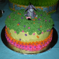 Eeyore Smash Cake 6 inch round black magic cake with buttercream frosting.