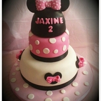 Minnie Mouse Cake 3 Tiered Cake White Velvet from scratch, filled with Vanilla Custard, iced in Butter Cream and covered in Fondant. All decor made of...