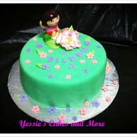 Dora The Explorer Yellow cake filled with Strawberry filling covered with bc and homemade fondant.