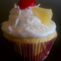 Pina Colada Cupcakes   Coconut pineapple cake with pineapple buttercream icing