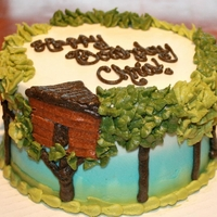 Treehouse Nature Cake A tree house nature cake. White to blue to green gradient on the sides, and trees all around. All buttercream