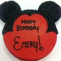Mickey Cake A mickey mouse silhouette birthday cake! Did my best to write in the Disney font as well.