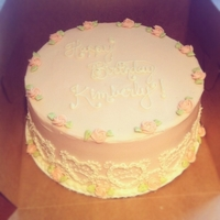Pink Champagne Cake Pink champagne cake, filled and frosted with vanilla buttercream.Heart lace detailing