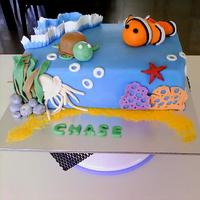 Finding Nemo Themed Cake For A Special Little Boys 2Nd Birthday Chocolate Mudcake With Chocolate Butter Cream And Vanilla Fondant Inclu *Finding Nemo themed cake for a special little boys 2nd Birthday. Chocolate mudcake with chocolate butter-cream and vanilla fondant....