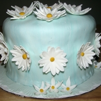 Daisy first fondant cake, i was going for a marbled look and made my own MMF