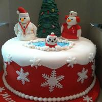 Merry Christmas!! Cancer Awareness Doctor & Nurse Theme Cake Cake: Yellow Buttermilk w/ BC CrumbcoatCovering: FondantSnowmen/Seal: FondantChristmas Tree: RCT covered in Fondant