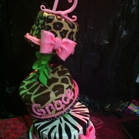 Jungle Theme Topsy Turvy Cake cake set up at the party