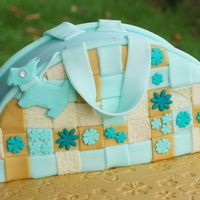 Radley Handbag Cake   A vanilla Birthday cake, decorated with fondant in a basket weave pattern and sugar flowers