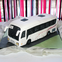 Bus Wedding Cake The groom and the bride meet together in a bus