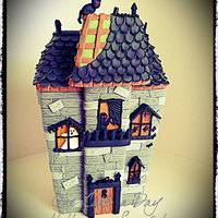 One Cake A Day Spooky Mansion Ginger bread house decorated with fondant and candies!