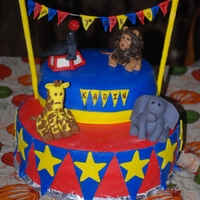 "Circus Carnival Birthday Cake  Circus/Carnival Birthday Cake with Fondant Sculptures"" Lion, Seal, Giraffe and Elephant. 2 layer 12"" bottom and 2 layer 9""..."