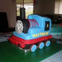 Thomas Train This was my 1st ever atempt at using fondant or carving a cake! Hmmm an easier shape would have helped to practise on 1st.