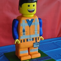 'emmet' Made this lego man cake 'Emmet' for my son's 6th birthday. 'Emmet' stood about 45cm tall and was choc mud cake.