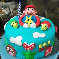 Super Mario My 3rd Fondant Cake. This was for my uncle. He loved this game and used to play it with my cousin - but he always lost. Haha I really...