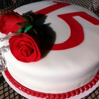 15Th Anniversary 2 layer 8 inch vanilla cake dyed red, covered in fondant with red fondant roses