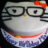 Hello Nerdy Kitty 2 layer vanilla cake with orange buttercream so it tasted like a creamsicle! covered in fondant and fondant decor.