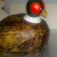 Pheasant Pheasant for father's day. Fondant head held in place with a Mikado stick and fondant support.