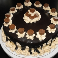 Reese's Peanut Butter Cake Chocolate cake, peanut butter buttercream and topped with mini Reese's peanut butter cups. A chocolate and peanut butter lover's...