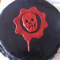 Gears Of War Black fondant and red skull logo fondant. My first fondant cake. I don't even know if this deserves to be on here because all the...