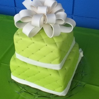 Olivia's Birthday This is a square cake with quilted fondant and a bow.