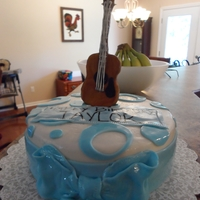 Guitar Birthday Cake Custom modeling chocolate guitar topper with UNC colored cake.
