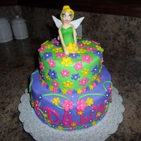 Tinkerbell Cake Custom gum paste Tinkerbell topper, 2 tier cake with a ton of gumpaste blossoms with sugar pearls.
