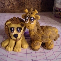 Gumpaste Lion And Giraffe Toppers Custom gumpaste lion and giraffe cake toppers for a baby shower. =)