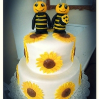 Sunflower And Bees Wedding Cake My 1st wedding cake. Custom gum paste bee bride and groom toppers. Gum paste sunflowers. Homemade fondant.