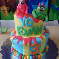 Yo Gabba Gabba Topsy Turvy Cake My 8th cake and my 1st topsy turvy cake! Homemade marshmellow fondant and modeling chocolate characters.