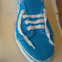 Vans Shoe Cake Chocolate sponge cake carved and iced to look like a Vans skateboarding shoe.