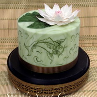 Lotus Garden Birthday cake with hand painted Koi and a sugar lotus flower